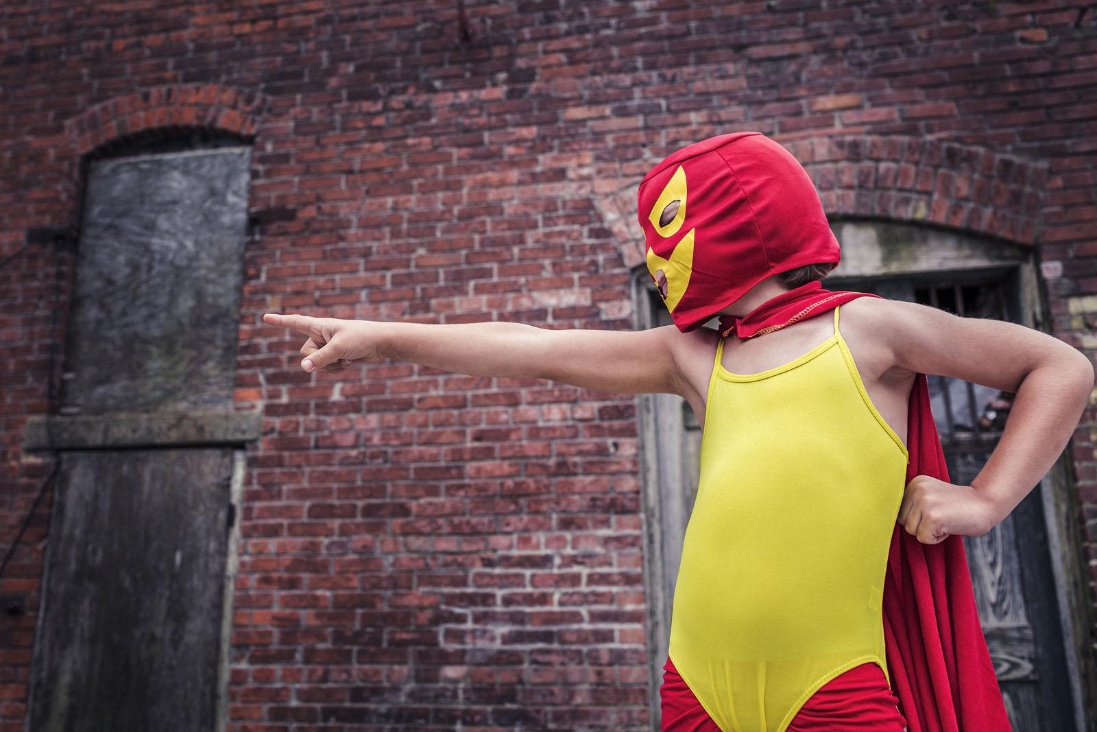 marketing superheros, boy dressed as masked hero