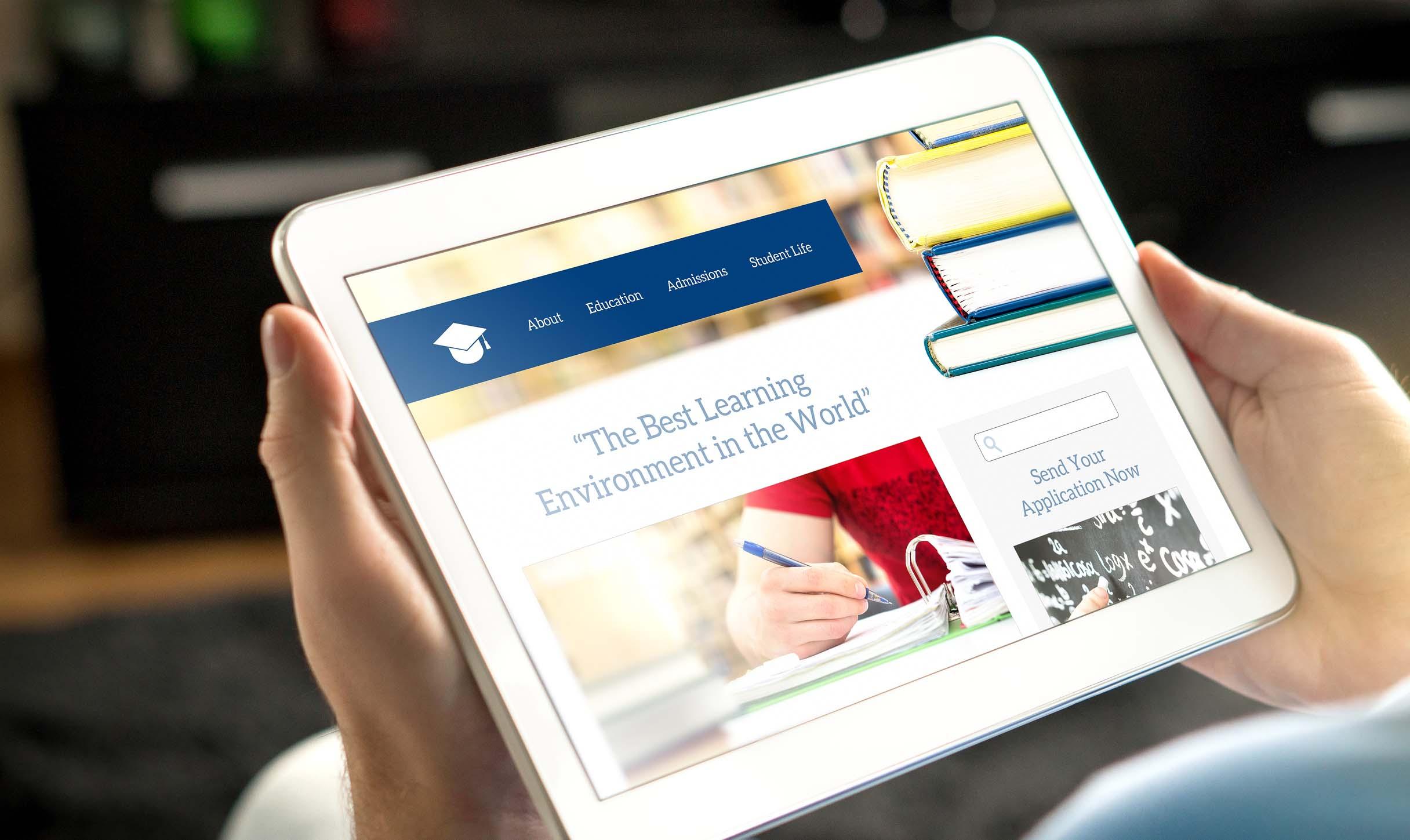 School website on tablet screen